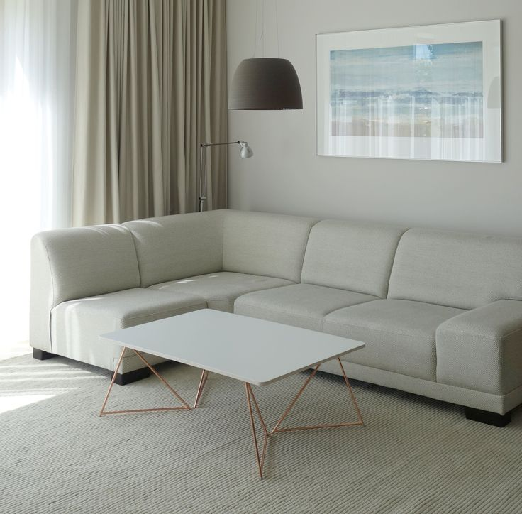 Copper coffee table and white table top with plywood edges.
