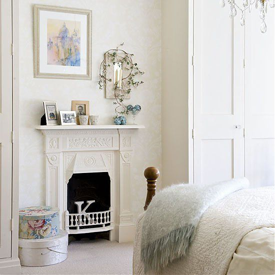 A white painted victorian fireplace, perfect for the master bedroom.