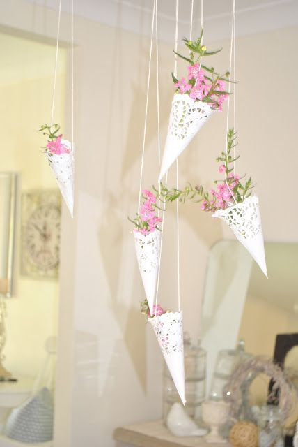 Peaches & Maple: Paper doily hanging baskets - would be cute with lavender hanging off the chairs