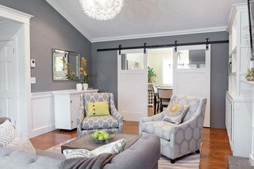 Wall color is Englewood Cliffs by Benjamin Moore.  It's A mid-tone gray.  Love it!