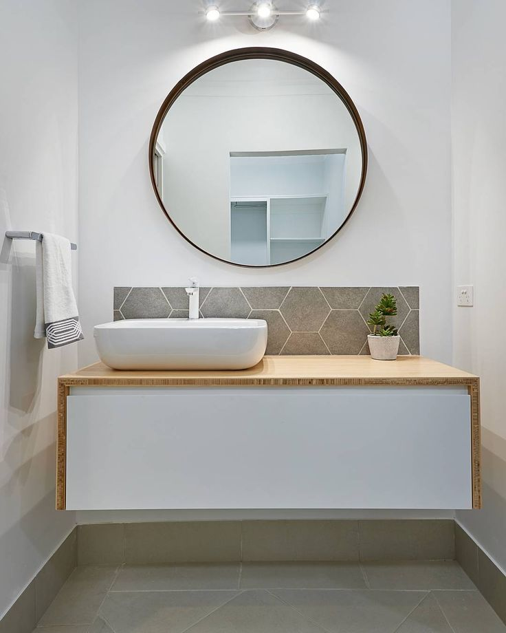 Ty Nichols of STR  Builders in Wagga Wagga, NSW have created a space perfect for guests. When you don't have lots of space, keep things neutral and simple with a few feature choices to add a bit of visual interest. Here they've used some hexagon tiles as a splashback to give this white room a bit of life.