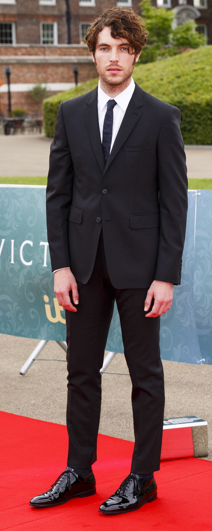 British actor Tom Hughes wearing Burberry tailoring to the premiere of Victoria in London's Kensington Palace