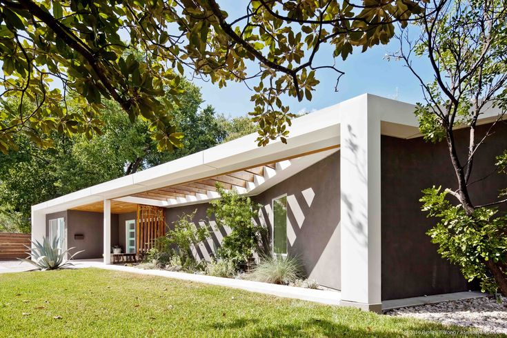 Completed in 2014 in Austin, United States. Images by Patrick Y. Wong. Originally built as a ranch-style house in 1962, the remodeled Y House is sensitively designed to weave into the fabric of the Sherwood Oaks...