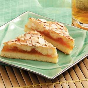 "Almond Apricot Bars Recipe -Apricot jam provides the fruit flavor in this small pan of sweet dessert bars shared by Olga Wolkosky of Richmond, British Columbia. ""They freeze well and are always a hit,"" she relates. ""They're also good with seedless raspberry jam instead."""