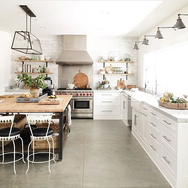 A gorgeous light & bright kitchen from @heatherbullard. Love all the windows & natural light pouring in!