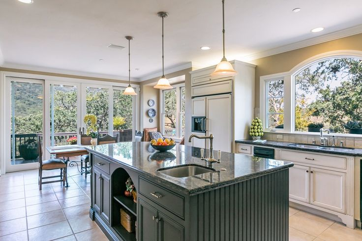 Cottage Kitchen with Stone Tile, Flat panel cabinets, Complex granite counters, Breakfast nook, Kitchen island, Window seat
