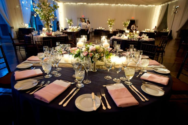 Navy table cloth and grey napkins with colorful flowers in centerpieces. Pretty! Especially if i had dark blue bridesmaids dresses