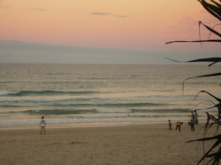 Gold Coast - playing on Surfers Paradise Beach at dusk - kicking up the sand and water.  #Gold Coast