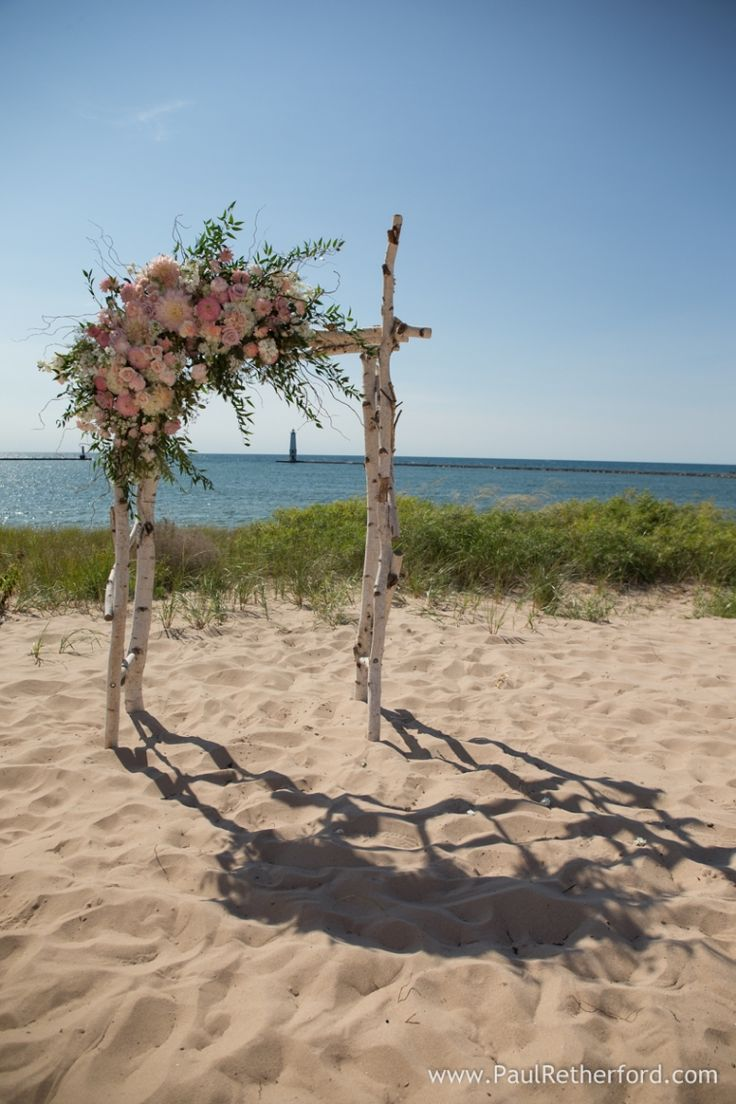 Harbor Lights Resort on Lake Michigan wedding arch frankfort michigan photo by…