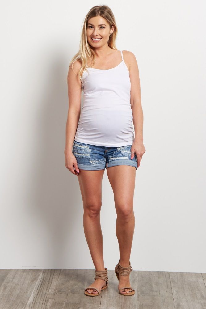 Your basic jean maternity shorts just got a make-over with this trendy piece. Heavy distressed details make for a stylish short you can keep comfortable in with an elastic waistband. Style it with your favorite maternity top for a complete ensemble.