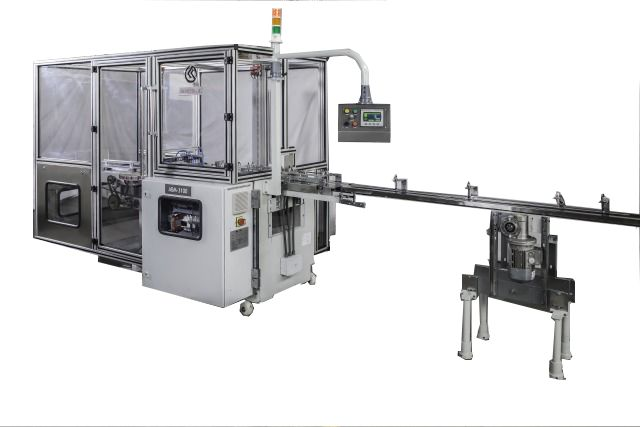 ABM 3100 is an adhesive tape application machine also called banding machine that automatically collates desired number of wrapped soaps in upright position and then applies printed adhesive tape on both sides.