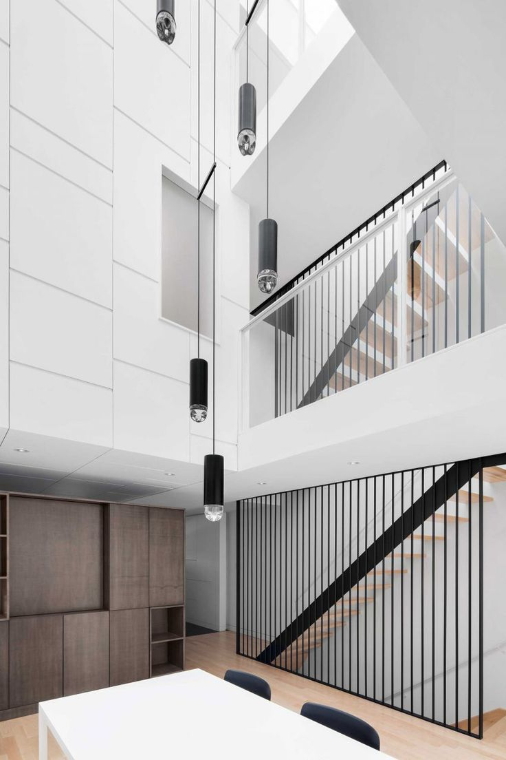 The renovation of this Montreal townhouse by local firm Naturehumaine centres around a triple-height atrium that brings daylight into living spaces on all floors.