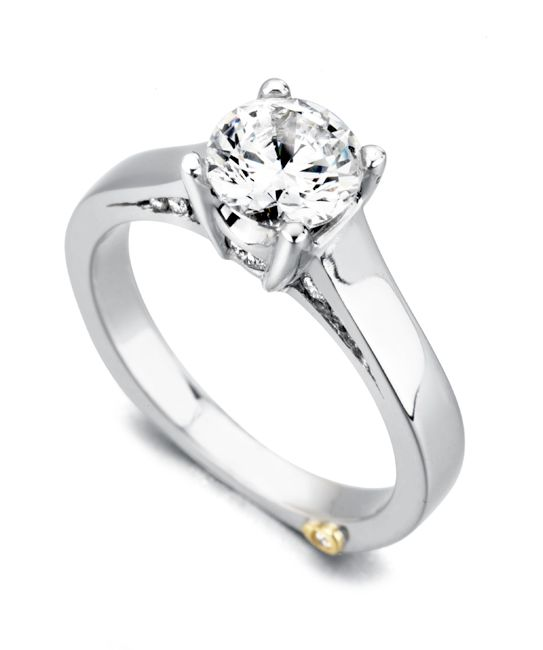 The Angel engagement ring contains 15 diamonds, totaling 0.225 ctw. Center stone sold separately, not included in price.The Angel wedding band contains no diamonds.