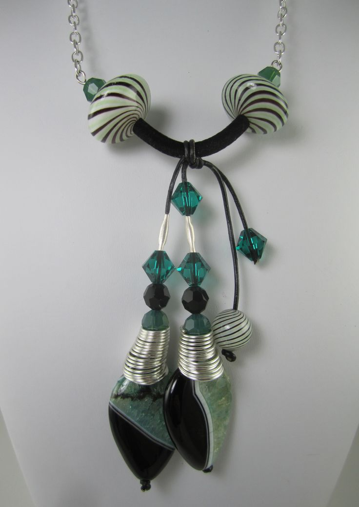 Balancing act of Green Agate with Swarovski Crystals and Lampwork Beads. Leather, suede cord,  stainless steel wire, chain and Conetastic cones by Beadalon/Artistic Wire. Design by Sandra Lupo