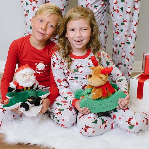 """Our comfy family matching pajama set features a jolly Santa Claus with """"Merry Christmas"""" messaging. Perfect for Christmas morning pictures, lounging on family night, or snuggling by the fireplace!  Men's  Shirt: Lightweight knit with long sleeves in a relaxed fit with contrast crew neckline and """"Merry Christmas"""" message with Santa graphic Pant: Lightweight knit in a relaxed fit with side pockets, elastic waistband, drawstring closure and allover print    Women's  Shirt: Ligh..."""