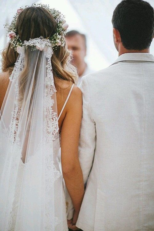 Bride and groom, flower crown with veil