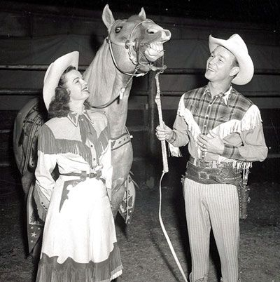 Dale Evans and Roy Rogers with Trigger. I love her outfit!  The old western costumes are just so fun :)
