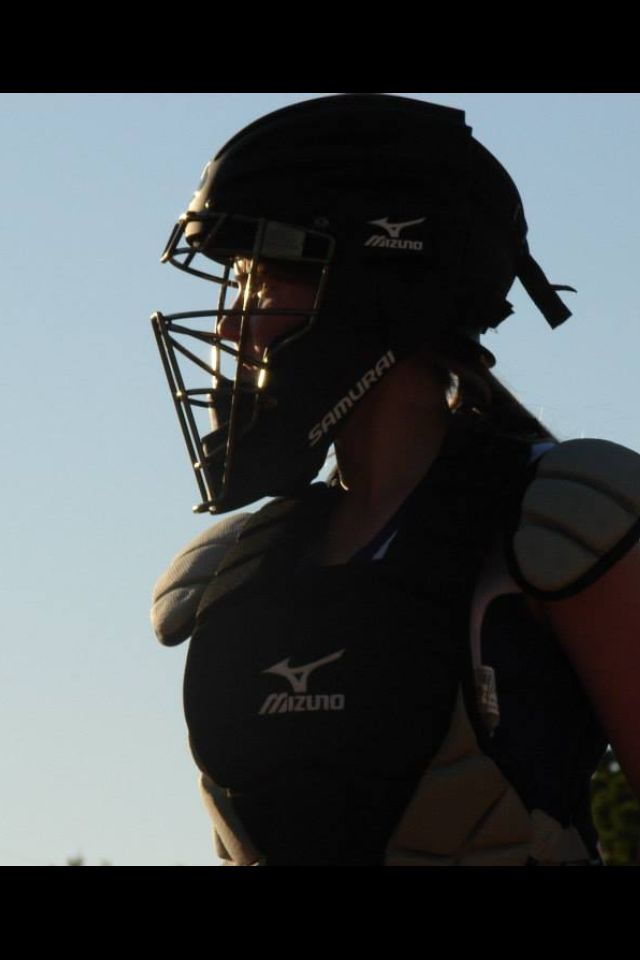 Softball Catcher!! This catcher is smart because she has pigtails and that way the helmet doesn't pull your hair
