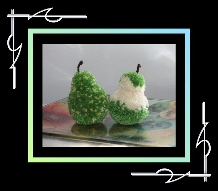 These are Sculptured Yarn (pompoms) fruits - a pear and a half-eaten pear. Available for purchase at thatissocool.ca
