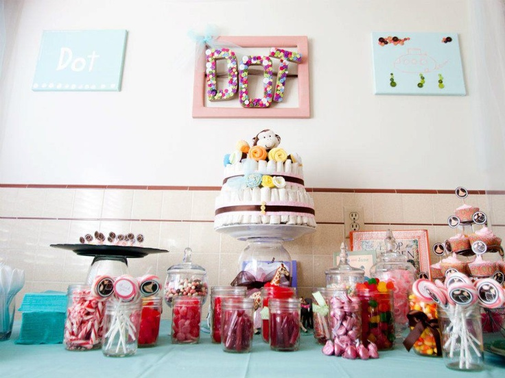 Diaper cake, candy bar, cupcakes and handmade pictures for baby shower decor.