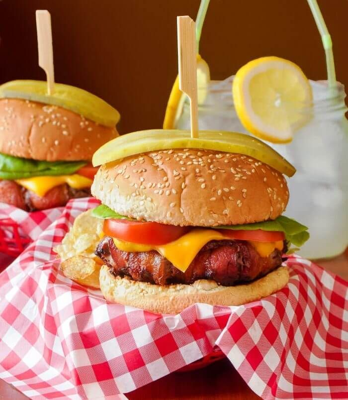 The Ultimate Bacon Wrapped Cheeseburger on Wonder Ballpark Classics Hamburger Buns. Up your burger game to championship level with these amazing, smokey bacon wrapped, juicy beef burgers. #sponsored