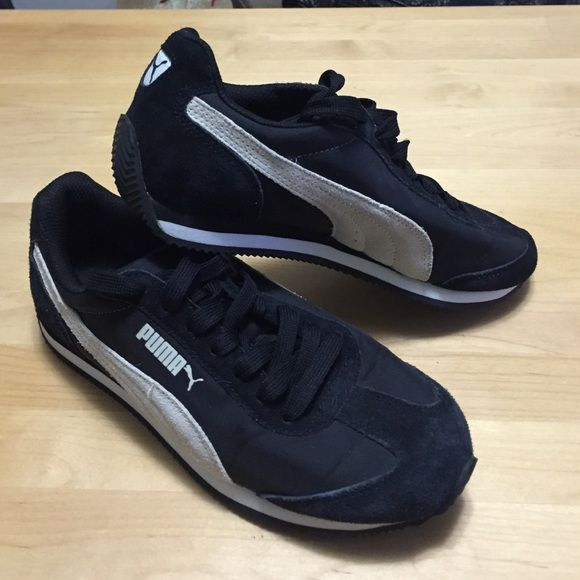 Puma tennis shoes Womens puma tennis shoes. Suede and nylon. Black with light greyish cream suede puma detail. Practically new. Wore it once on a 3 day cruise. Puma Shoes Athletic Shoes