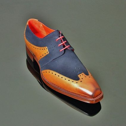 Dexter - 'Freebo' Slot Punch Gibson in Handburnished Mahogany calf and Navy Suede. Also available in Deep Red Polish, Tan Polish and Tan Calf. #jefferywest #britishfootwear #bestofbritish #mensfootwear #mensshoes #gibsonshoes #dexter #fashion #alternative