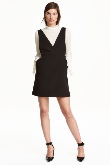 V-neck dress: Short, sleeveless dress in a stretch weave in a narrow cut at the top with a deep wrapover V-neck front and back, a seam at the waist, side pockets and a concealed zip in the side. Lined at the top.