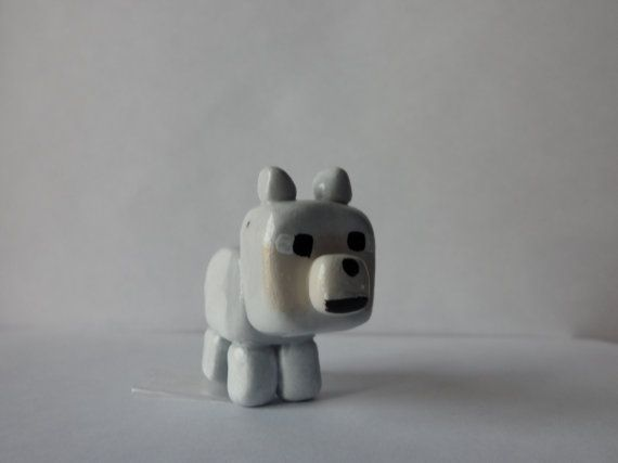 Minecraft Wolf. I'm guessing it's made of clay... ----- Whatever it's made if, it's cute.