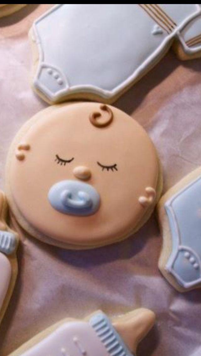 galletitas de  biberones, bodys de bebes y una carita de bebe