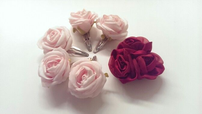 Day Five: Realistic pink foam tea-rose hair clips and a red ribbon rose hair clip made up of three roses