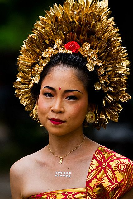 Pretty Balinese Woman in Beautiful traditional dress, at Kuta Beach; pinned by…