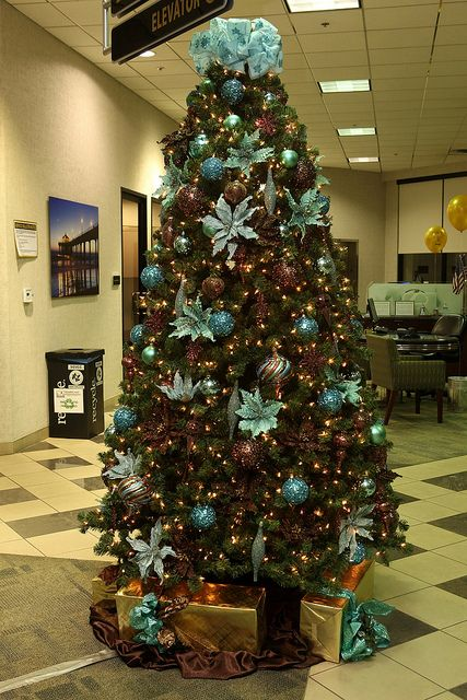Teal and brown Christmas tree with peacock feathers! I really need to get into a house soon!