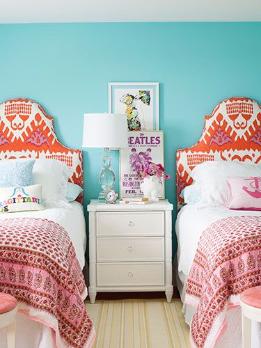 Small throw pillows by Jonathan Adler and cotton sari blankets layer on extra personality.