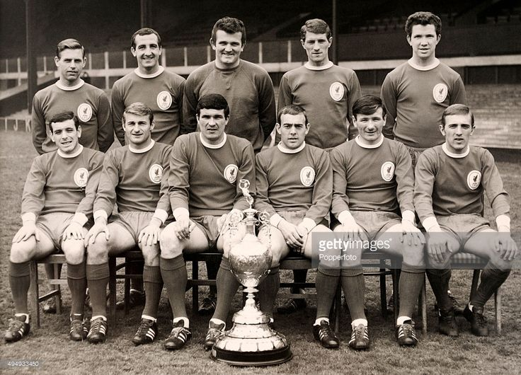 The Liverpool team with the 1st Division Championship trophy, circa August 1966. Back row, left to right: Gordon Milne, Gerry Byrne, Tommy Lawrence, Geoff Strong and Chris Lawler; front row, left to right: Ian Callaghan, Roger Hunt, Ron Yeats, Ian St John, Tommy Smith and Peter Thompson.