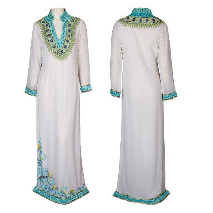 A gorgeous floor-length white Kaftan dress with a Mandarin collar by Mynahs. Brocade embellishment on the sleeves, neckline, and hemline #mynahs #kaftan #gbmoda #mandarin #brocade #embellishment #elegance #fashion #ramadan #abudhabi #greenbird #dubaifashion #marinamall #trend #luxury #hautecouture #dress