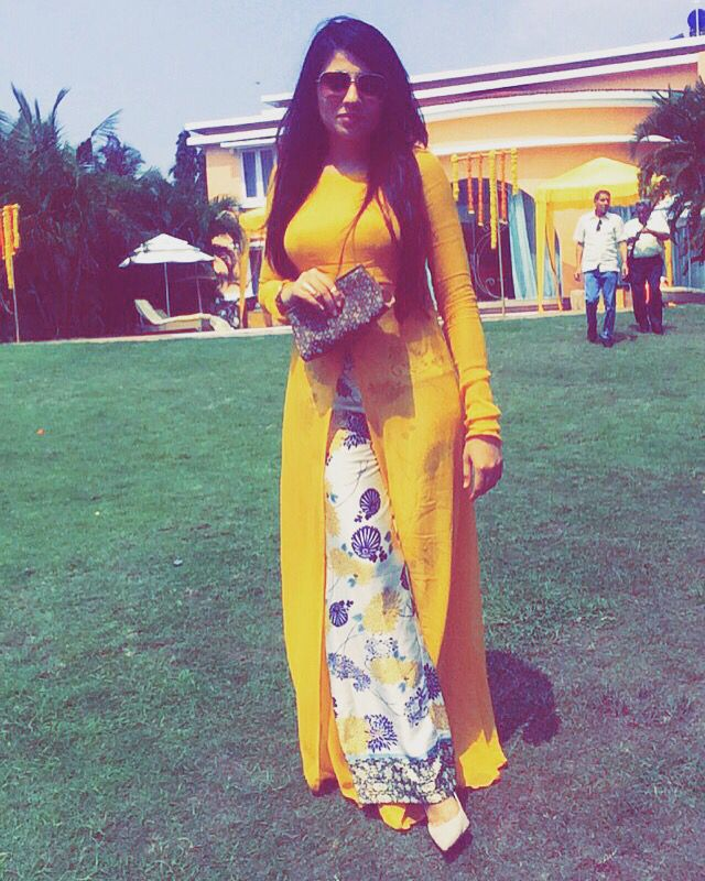 All yellow In yellow for the Haldi function.   Beachside Wedding