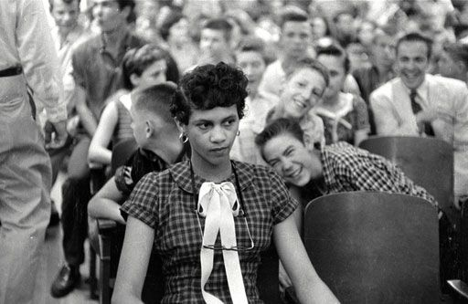 Charlotte, North Carolina (1957)    A photo of Dorothy Counts, being jeered and taunted by her white, male peers. She was the first black girl to attend an all white school in the United States.
