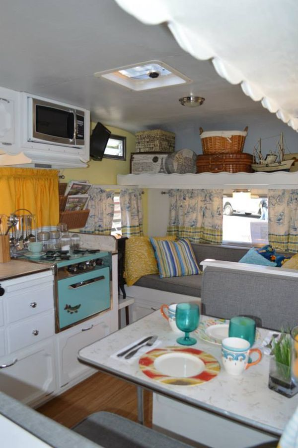 love how the overhead storage is used.  Could be great for one of those overhead beds in a RV