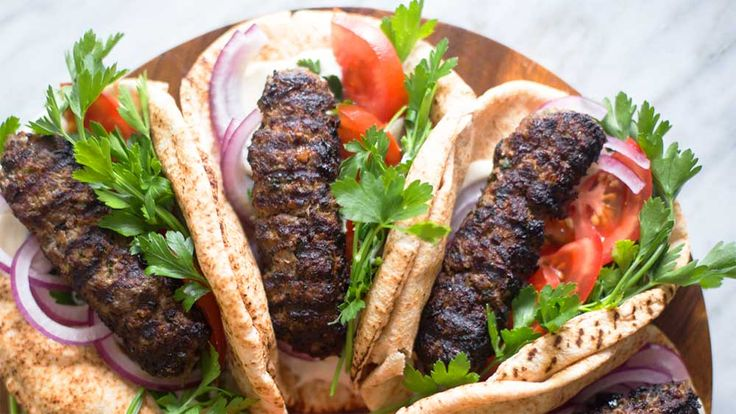 Incredibly+juicy,+lightly+spiced,+charred+beef+fingers,+perfectly+wrapped+in+warm+pita+bread.