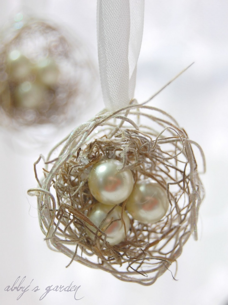 "bird nest ornament...how easy to make...I could even spray paint the ones I have found white and put some pretty ""pearls"" in them"
