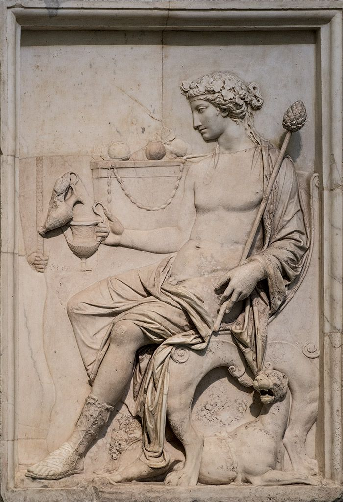 Sitting Dionysos.      Neo-Attic relief.     Marble. 1st cent. A.D.     Inv. No. 6728.     Naples, National Archaeological Museum.