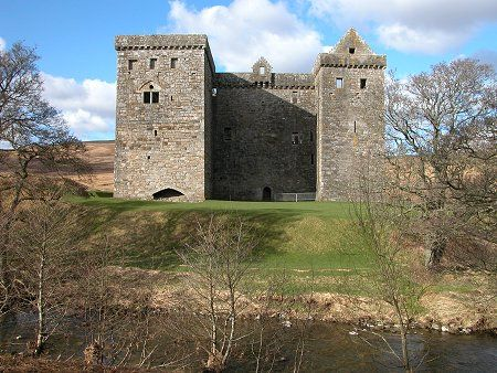 """Hermitage Castle Seen Across the Hermitage Water - """"I know of no ruin which is so impressive as Hermitage Castle...which looks as if it might, at any moment, pour forth from the great doorway a troup of Border Riders with their leather jackets, their steel caps, and their faces set southward.""""  Lord Ernest Hamilton, Old Days and New"""