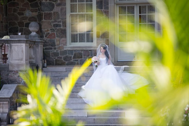 Graydon Hall Manor bride walking down stairs to outdoor ceremony