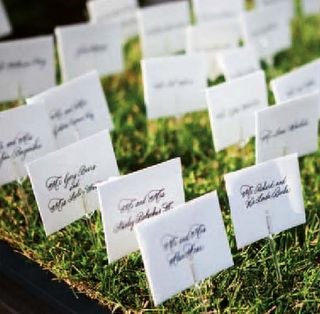 """For a football themed wedding is to use grass or the """"football field"""" in your decor a perfect place to set your place cards!"""