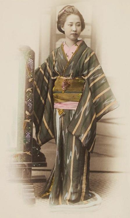Japanese woman in a kimono, ca. 1870.