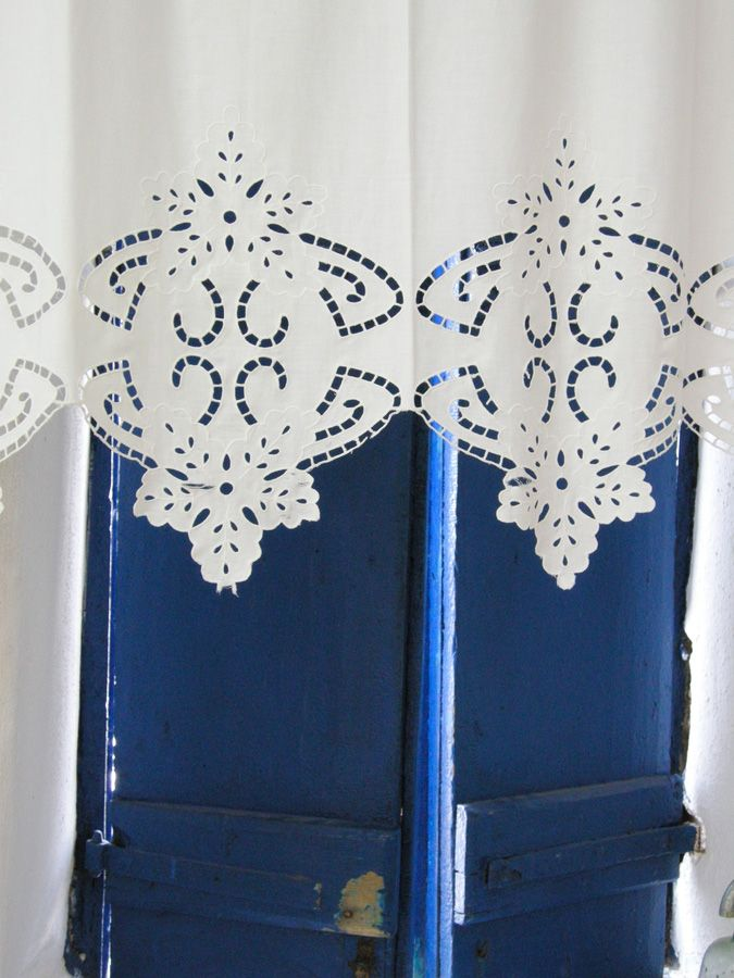 An elegant Greek embroidered curtain, Paros Island , photo by Carla Coulson