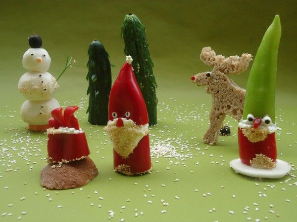 Santa Clause and friends in the kitchen = edible figures made from vegetables