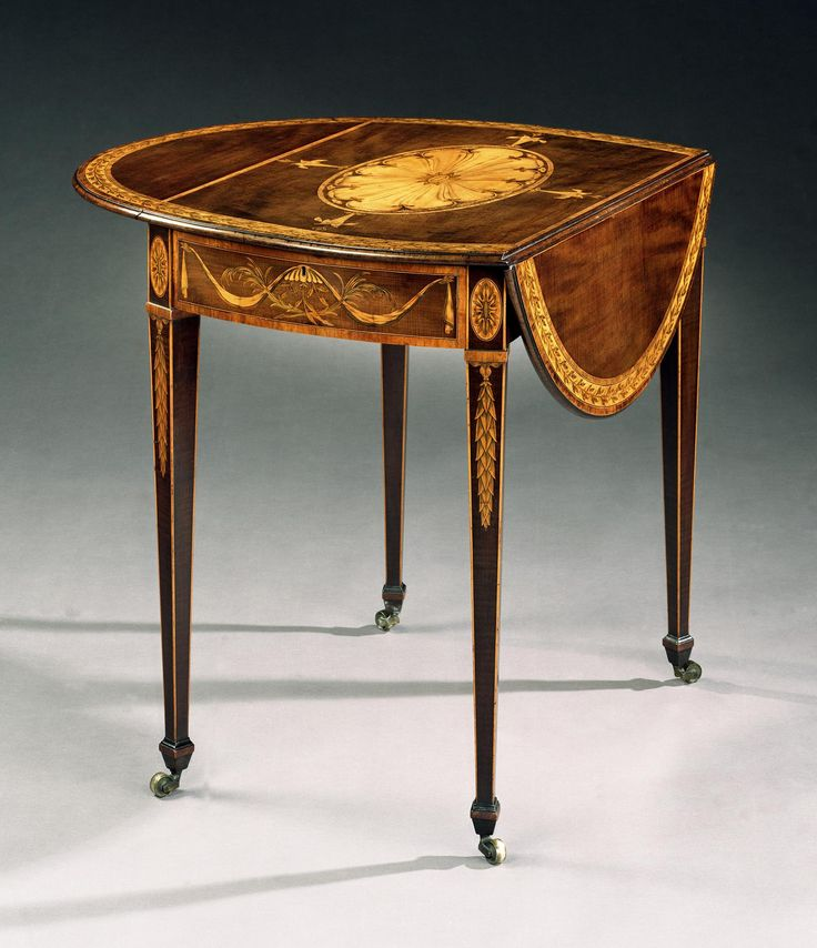 A GEORGE III HAREWOOD OVAL PEMBROKE TABLE BY GEORGE SIMSON
