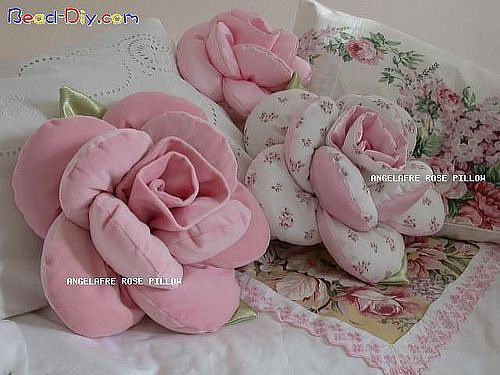 """Stuffed Fabric Flower """"Pillows"""" -- In French but there is a pattern.  She does say just to increase the size if you would like to make a bigger flower.  From http://secretsdetiroirs.over-blog.com"""